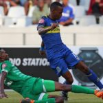 Surprise Ralani of Cape Town City FC tackled by Lucky Baloyi of Bloemfontein Celtic