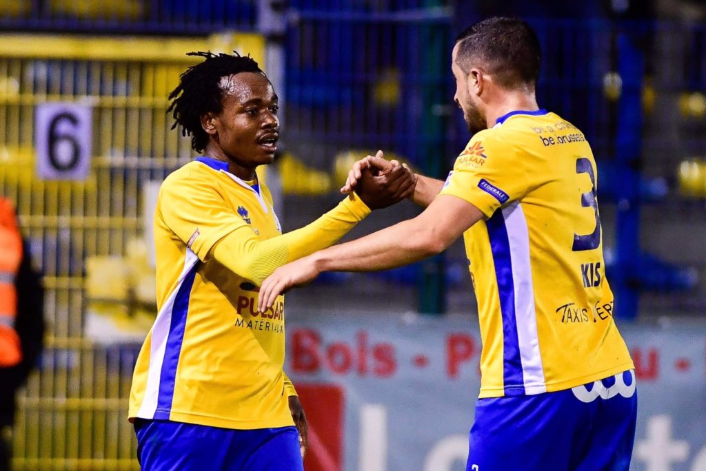 Percy Tau celebrates his brace with teammate